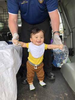 Vaccine Mobile treating a toddler